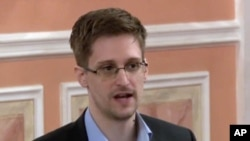 In this image released by WikiLeaks Oct. 11, 2013, former National Security Agency systems analyst Edward Snowden speaks during a presentation ceremony in Russia.