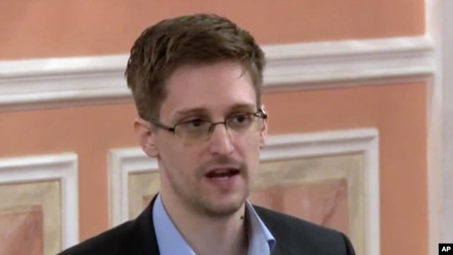 In this image made from video released by WikiLeaks on Friday, Oct. 11, 2013, former National Security Agency systems analyst Edward Snowden speaks during a presentation ceremony in Russia.