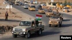 28일 이라크 쿠르드 자치정부군 병력이 북부 기지를 떠나 코바니로 향하고 있다.