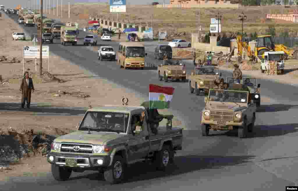 دولت اسلامیہ کے شدت پسندوں سے لڑائی کے لیے، عراقی کُرد پیش مرگہ جنگجو شام کے شہر کوبانی کی طرف روانہ ہوئے۔