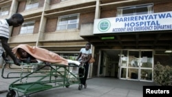 FILE: A patient is taken home on a stretcher by his relatives from Parirenyatwa hospital's accident and emergency ward in the capital Harare .