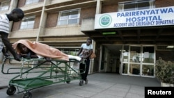 FILE: A patient is taken home on a stretcher by his relatives from Parirenyatwa hospital's accident and emergency ward in the capital Harare August 21, 2009. State doctors are currently demanding an upward review of their allowances.
