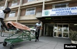 FILE: A patient is taken home on a stretcher by his relatives from Parirenyatwa hospital's accident and emergency ward in the capital Harare August 21, 2009.