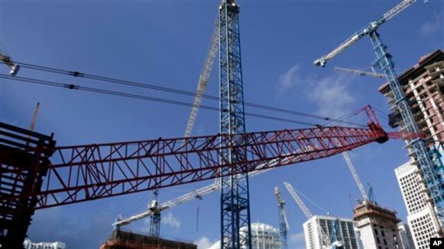 This Thursday, July 24, 2014 photo shows construction cranes at the Brickell City Centre project in downtown Miami. (AP Photo/Lynne Sladky)