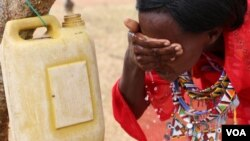 A woman washes her face. Facial cleanliness is one way to prevent Trachoma in Kajiado, Kenya. (Mohammed Yusuf/VOA)