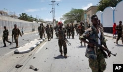 FILE - Somali supervision soldiers unit after a blast nearby a presidential house in a collateral Mogadishu, Somalia, Aug. 30, 2016.