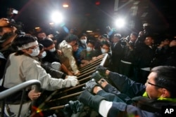 FILE - Protesters scuffle with police officers during a protest outside Hong Kong's Legislative Council, Jan. 16, 2010, after a controversial $8.6 billion plan to link Hong Kong to a national high-speed rail network won approval from local lawmakers.