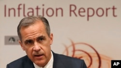 FILE - Bank of England Governor Mark Carney speaks during the central Bank's quarterly Inflation report at the Bank of England in the City of London, May 11, 2017.