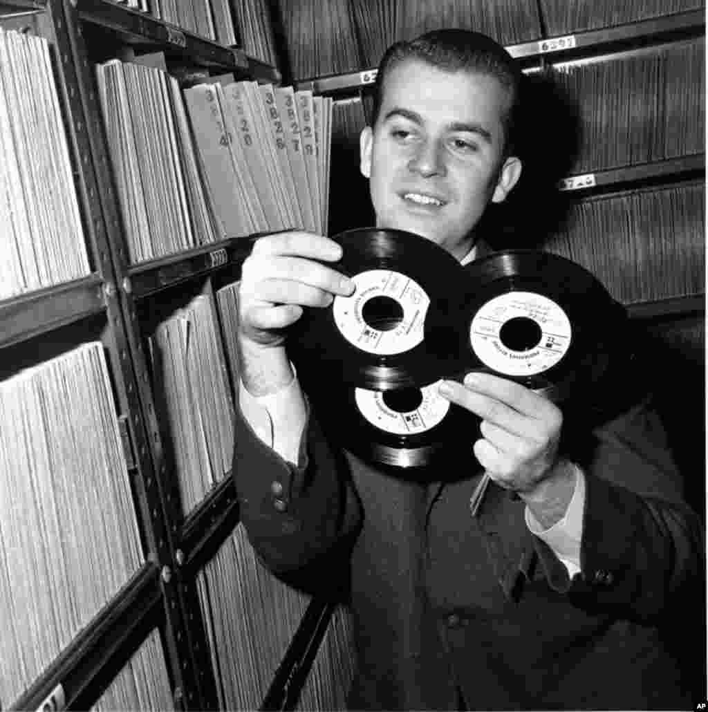 Dick Clark, pictured in 1959, selects a record in his station library in Philadelphia. The television host died April 18, 2012 of a heart attack. He was 82. (AP)