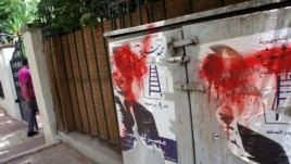 Posters of Eygptian presidential candidate Ahmed Shafiq defaced outside his Cairo headquarters, May 29, 2012. (Elizabeth Arrott/VOA)