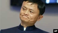 Jack Ma appears at a meeting in Davos, Switzerland earlier this year. He has answered questions about the company he started, Alibaba.