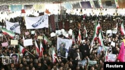 Iranians take part in the funeral of Sanee Zhaleh, a student who was shot dead during an opposition rally on in Tehran, February 16, 2011
