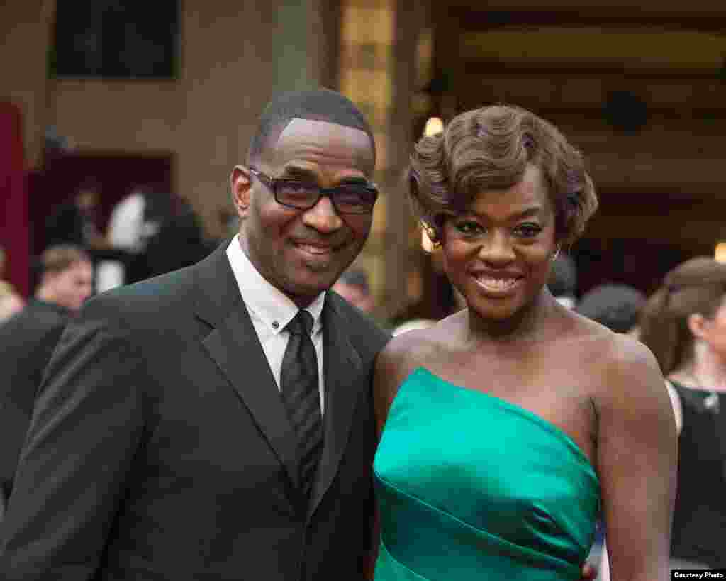 Julius Tennon (left) and Viola Davis arrive for the live ABC Telecast of The 86th Oscars® on March 2, 2014 in Hollywood, CA. (Photo courtesy AMPAS)