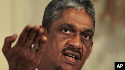 Sri Lanka's former army chief Sarath Fonseka gestures while speaking during a media briefing in Colombo, Sri Lanka, June 14, 2012.