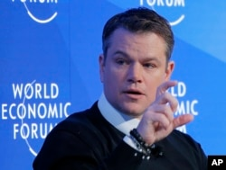FILE - U.S. actor Matt Damon gestures as he speaks at the World Economic Forum in Davos, Switzerland, Jan. 17, 2017.