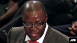 FILE: Zimbabwe's Finance Minister Tendai Biti delivers his speech about the 2013 budget at the Parliament in Harare, Zimbabwe, November 15, 2012.