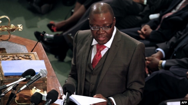 Zimbabwe's Finance Minister Tendai Biti delivers his speech about the 2013 budget at the Parliament in Harare, Zimbabwe, November 15, 2012.