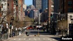 An investigator walks across Boylston Street near the site of the bombings in Boston, April 21, 2013.