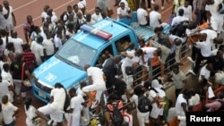 Applicants scale a fence during a job recruitment drive in Abuja March 15, 2014.