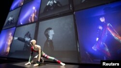 "A striped asymmetric catsuit by Yansai Yamamoto (1973), used by performer David Bowie, is seen at the ""David Bowie is"" Exhibition in London, March 20, 2013."