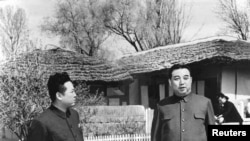 The late North Korean leader Kim Jong-il (L) and his father, the late North Korean founder Kim Il-sung, are seen in this undated photo released by state media.