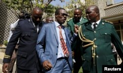 Kenyan Member of Parliament for Ugujna Constituency Opiyo Wandayi (C) is ejected from the National Assembly for blowing whistles during President Uhuru Kenyatta's annual State of the Nation address at the Parliament Buildings in Nairobi, March 31, 2016.