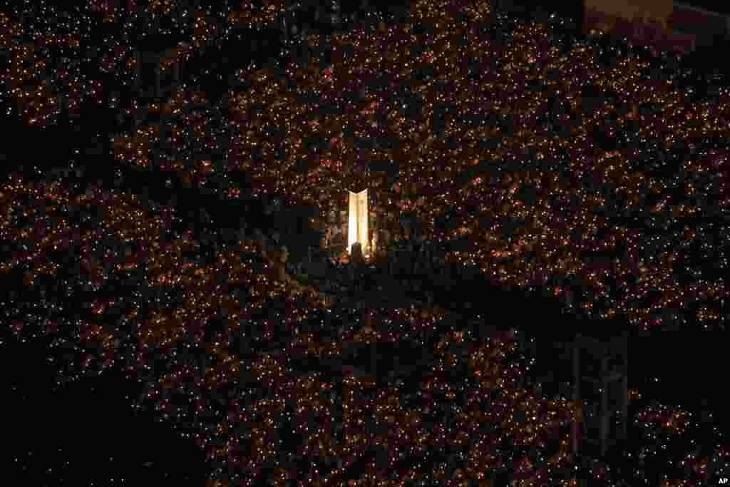 Tens of thousands of people attend a candlelight vigil at Victoria Park in Hong Kong to mark the 25th anniversary of the crackdown in China's Tiananmen Square.