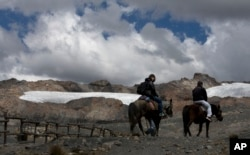 "A group of tourists ride horses to the Pastoruri glacier in a tour called ""The Route of Climate Change"" in Huaraz, Peru, Aug. 12, 2016."