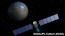 """Pesawat antariksa """"Dawn"""" mengorbit planet kerdil """"Ceres"""" antara Mars dan Yupiter (foto: NASA)."""