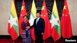 2016年8月19日,中国国家主席习近平在北京钓鱼台国宾馆会见到访的缅甸领导人昂山素季。(路透社图片)