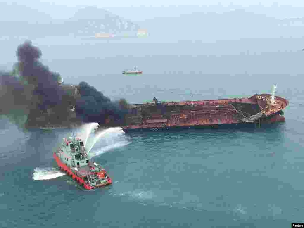 An oil tanker burns near Lamma Island, Hong Kong, China.
