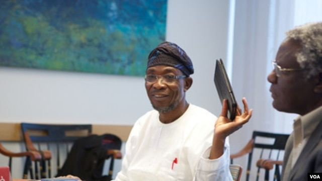 Engineer Rauf Aregbesola (l) is Osun State governor