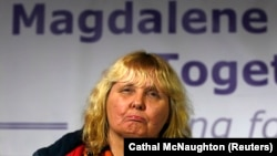 "Mary Smyth who was born in a ""Magdalene Laundry"", reacts during a ""Magdalene Survivors Together"" news conference in Dublin, February 5, 2013."