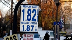 Gas prices are displayed at a service station in Leonia, N.J., Tuesday, Nov. 24, 2015. With Thanksgiving gas prices falling, the number of travelers is expected to rise, with one traffic-tracking firm predicting delays could be noticeably longer than last year. (AP Photo/Seth Wenig)