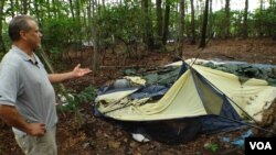 Richard points to what's left of the tent he called home for two years.