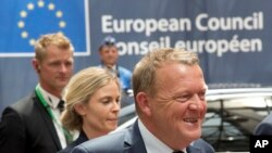Danish Prime Minister Lars Lokke Rasmussen, right, arrives for an EU summit in Brussels on Tuesday, June 28, 2016. said his minority government would push ahead with a bill to reject asylum seekers at the borders in times of crisis even though such a move might breach the European Union's Dublin rules.