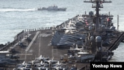 "U.S. aircraft carrier USS Carl Vinson arrives for an annual joint military exercise called ""Foal Eagle"" between South Korea and U.S, at the port of Busan, South Korea, March 15, 2017."
