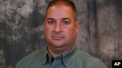 FILE - East Baton Rouge Sheriff's deputy Brad Garafola, 45.