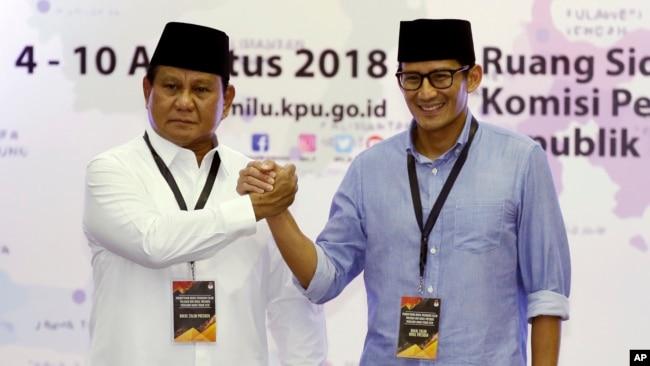 Capres Prabowo Subianto dan Cawapres Sandiaga Uno (Foto: AP).