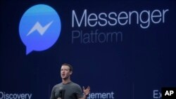 FILE - CEO Mark Zuckerberg talks about the Messenger app during a Facebook developer conference March 25, 2015, in San Francisco.