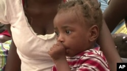 Child in shelter for earthquake survivors in Haiti