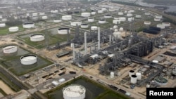FILE - A petrochemical plant is shown in this aerial view after Hurricane Ike moved through the area in Port Arthur, Texas, Sept. 14, 2008.
