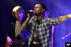 Adam Levine of the musical group Maroon 5 seen at Universal Music Group: Lucian Grainge's 2015 Artist Showcase Presented by American Airlines and Citi at The Ace Hotel, Feb 7, 2015, in Los Angeles.