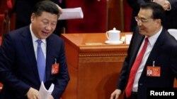 Chủ tịch Trung Quốc (bên trái) và Thủ tướng Trung Quốc Lý Khắc Cường tại phiên khai mạc Đại hội đại biểu nhân dân toàn quốc hàng năm, ngày 5/3/2017.