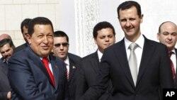 El presidente Hugo Chávez y Bashar al Assad durante la visita del gobernante venezolano a Damasco en octubre de 2010.