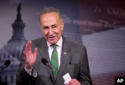 FILE - Senator Charles Schumer speaks to reporters on Capitol Hill about the Supreme Court decision on campaign financing, April 2, 2014.