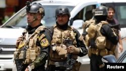 Miembros de las Fuerzas de Irak de Operaciones Especiales custodian Bagdad.