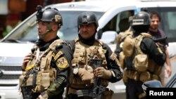 Les membres des Forces d'opérations spéciales irakiens montent la garde lors d'un déploiement de sécurité intensive dans le quartier Amiriya à Bagdad , le 18 Juin , 2014.