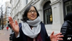 Cecillia Wang, deputy legal director of the American Civil Liberties Union, answers questions outside the 4th U.S. Circuit Court of Appeals building in Richmond, Va., Dec. 8, 2017. The court listened to arguments Friday on the latest version of President Donald Trump's travel ban.