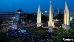 Pro-democracy protesters use mobile phones as flashlights as they attend a rally to demand the government to resign, to dissolve the parliament and to hold new elections under a revised constitution, near the Democracy Monument in Bangkok, Thailand, Augus